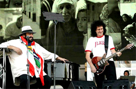 BRIAN MAY AND PAVAROTTI Luciano Pavarotti and his Friends, an organization created to help and support carity organizations around the world, a big concert every summer in Modena Italy with Brian May from Queen, Steve Wonder, George Michael, Zucchero, Laura Pausini, Lady Diana as special guest, The Spice girls, Andrea Bocelli, Bono from U2, Liza Minelli, and an incredible list of international guest coming to help childrens as Luciano's Friends